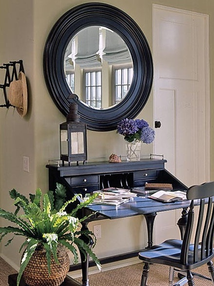 Round mirror with black frame. Hobby Lobby has large distressed one very similar. Buy it when it's half off!
