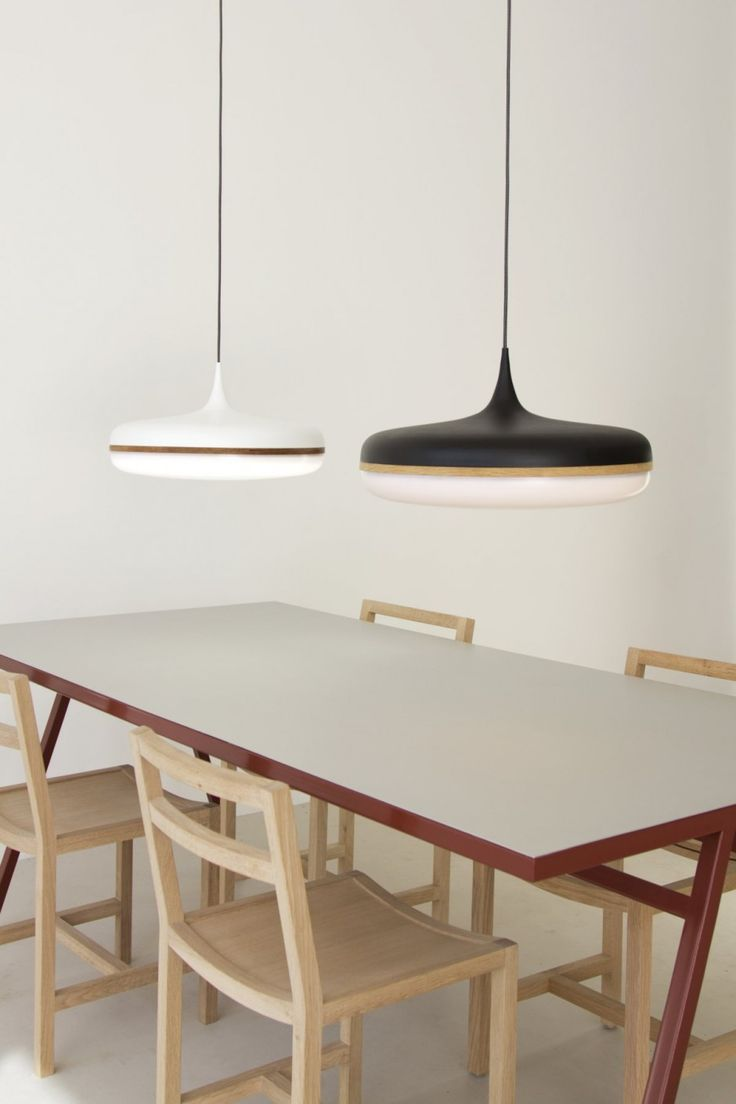 Australian-based industrial designer Viktor Legin has created Droplet, a pendant light made using spun aluminium and wood.