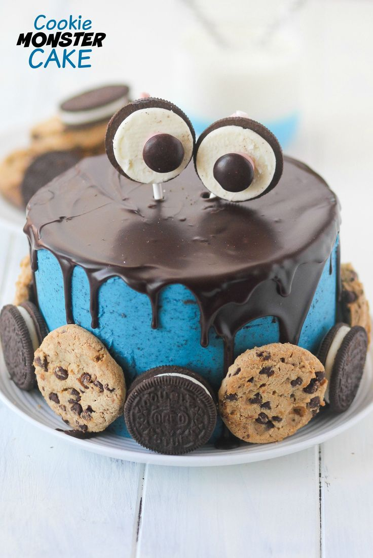 Cookie Monster Cake is adorable and full of COOKIES! Cookie lovers will go crazy for this creation! Is there a better way to start off a week than with a triple layer cake packed with COOKIES? I didn't think so. Last week kicked my butt. Lucy has had some kind of snotty funk that has been making it's way through the house.  Said snotty funk has made it impossible for her to breathe through her nose, and therefor, impossible to sleep. Which means that I am not sleeping, either. And isn't it…