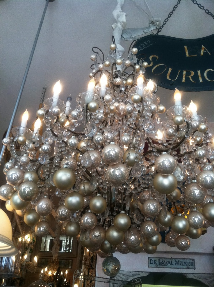 WOW Silver Christmas Ornaments Hanging From A Chandelier