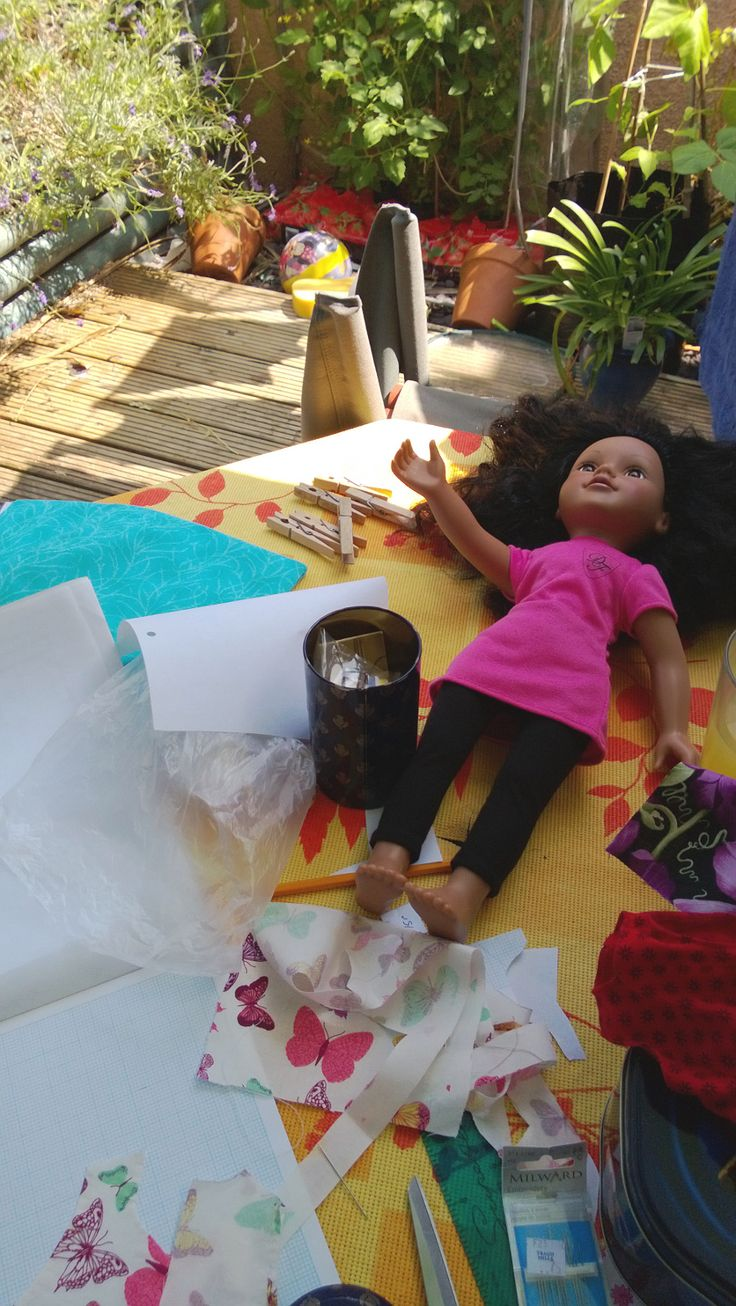 Making dolly clothes in the garden.  My daughter's birthday is in summer which creates an ideal opportunity to while away a few afternoons with my sewing machine in the sunshine