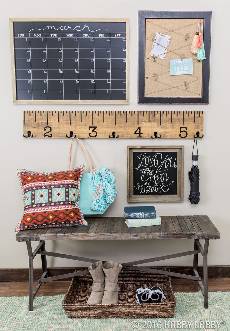 Excite your entryway with a playful gallery wall that's organized and oh-so-chic!
