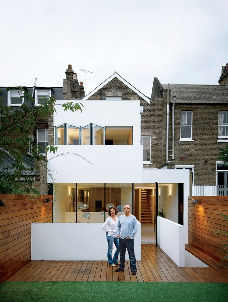 Bruce Thatcher and Kirsty Leighton behind their London home.