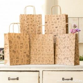 Surtido de 5 bolsas de papel de regalo estampadas con asas