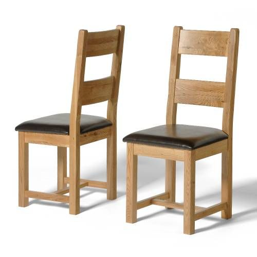 Reclaimed Oak Furniture Reclaimed Oak Dining Chairs (faux leather seat) x2 These stylish and affordable chairs will match perfectly with your new dining table. With comfortable faux leather padding, your dinner party guests will never want to leave! Made with solid oak, take http://www.comparestoreprices.co.uk/dining-furniture/reclaimed-oak-furniture-reclaimed-oak-dining-chairs-faux-leather-seat-x2.asp