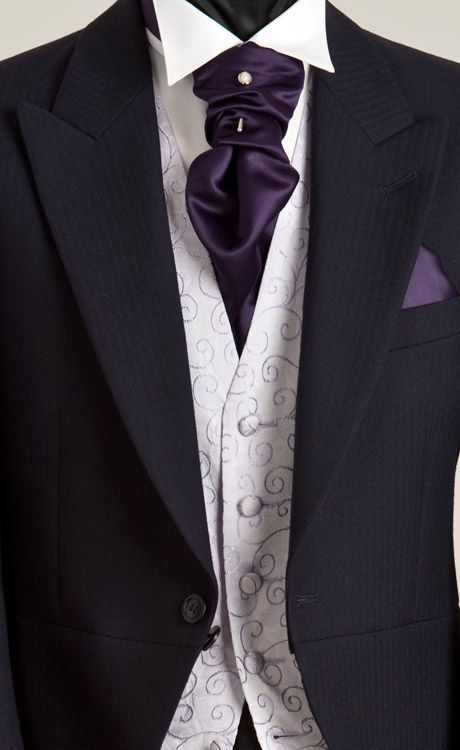 Nice suit. Not crazy about the purple, but the styling of the cravat and pocket square is nice.
