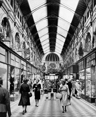 Royal Arcade - Melbourne Australia - this is a photo if the arcade around the 1960's - notice the change in detail to today! ( especially above the main window shop fronts )