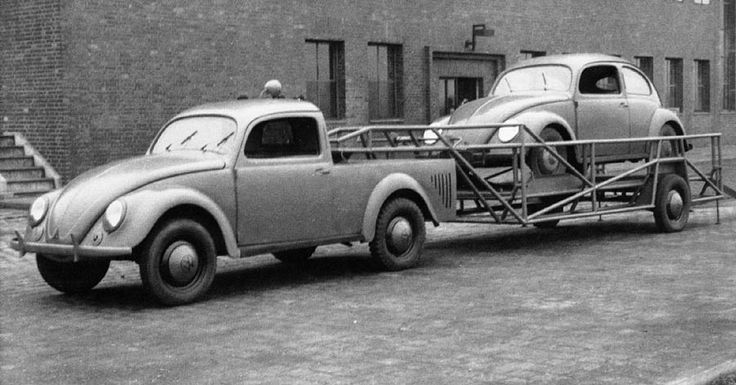 """I thought I'd seen every old VW oddity, but doing a google image search for """"VW pickup"""" brings up this gem. I knew that in the early days the VW factory built a number of specialized vehicles to transport bodies and things around the grounds. But this goose neck fifth wheel trailer rig hauling another Beetle takes the cake."""