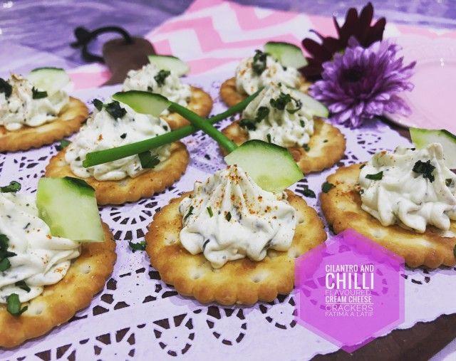 Cilantro And Chilli Flavored Cream Cheese On Crackers