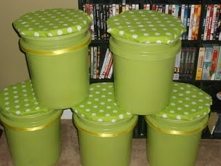 Someone made stools out of 5 gallon paint buckets. Here is how I made them: Went to Lowes and got 5 buckets and lids. Then went to Hobby Lobby and bought foam & fabric. Bought spray adhesive & thin pieces of round wood. Spray painted my buckets green to match theme. Glued the wood to the foam and wrapped fabric around them. Then glued the cushion to the bucket lid; dded a little ribbon to give it a little more cuteness.