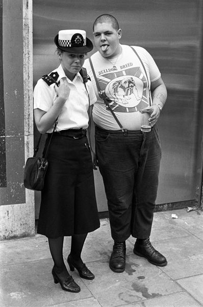 Policewoman and skinhead, Chelsea, London, England, United Kingdom, 1981, photo by Derek Ridgers.