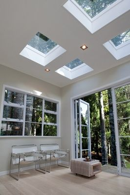 What a fantastic finish to this flat roof extension. The 4 flat glass rooflights…