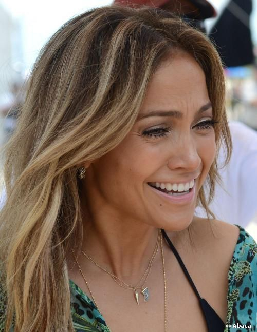 Showing off her highlighted hair and tan skin, actress and singer Jennifer Lopez posed on the beach. She's not just being a beach bum-...