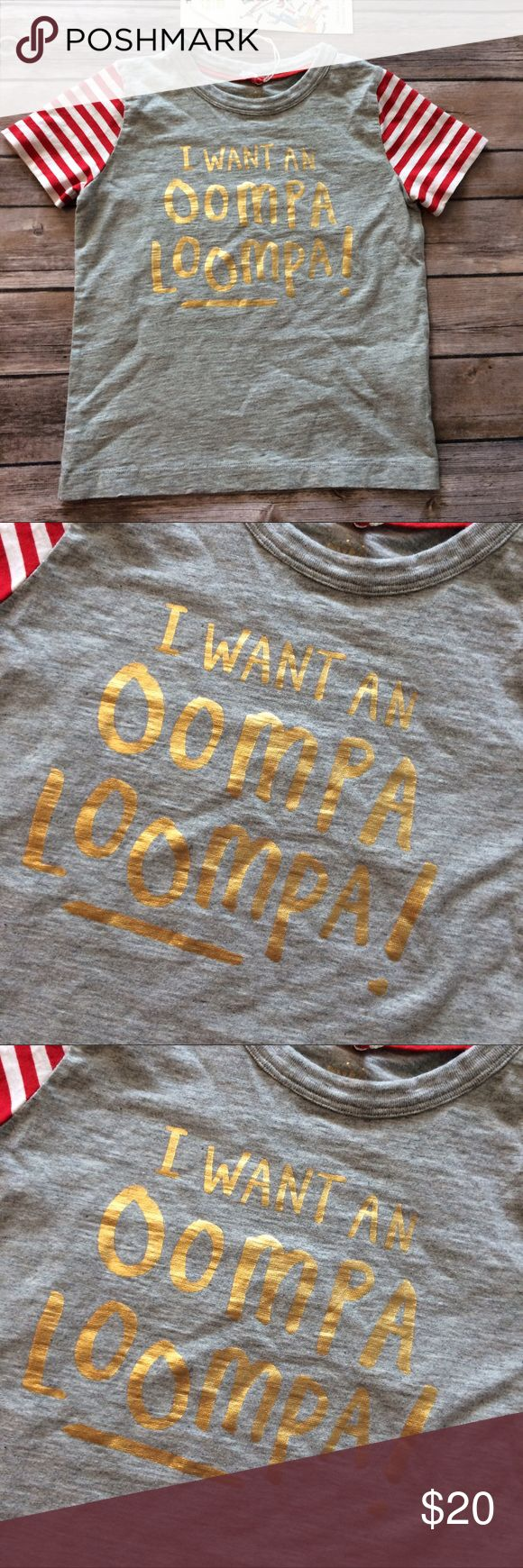 "Mini Boden Oompa Loompa shirt size 2-3 years Gray shirt with gold metallic lettering and red and white striped short sleeves. ""I want an Oompa Loompa."" Found in the girls' section but unisex imo. Tag size 2-3 years. Part of the Roald Dahl collection. Smoke free dog friendly home. Always a bundle discount in my closet. Mini Boden Shirts & Tops"