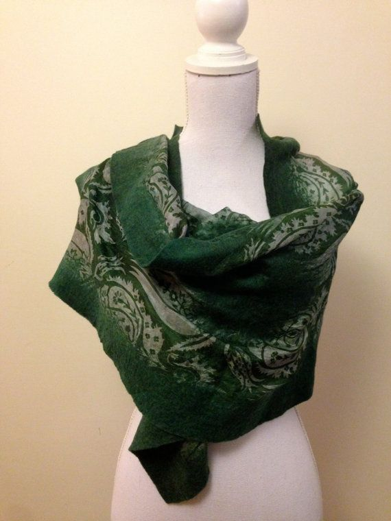 Forest Green - felted wool shawl with pretty floral silk inlay - soft, warm and beautiful. Made in Turkey using best quality wool from Australia and New Zealand along with sari silk from India. These are hand made and hand dyed using traditional methods. Dyes include colours created using natural elements such as walnut and onion skin. They are absolutely beautiful either worn casually or dressed up for a special occasion. The shawl has areas of contrasting coloured felt incorporated into…