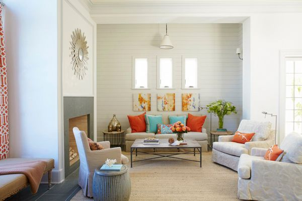 Living room decorated with corals and aqua colors | Revedecor