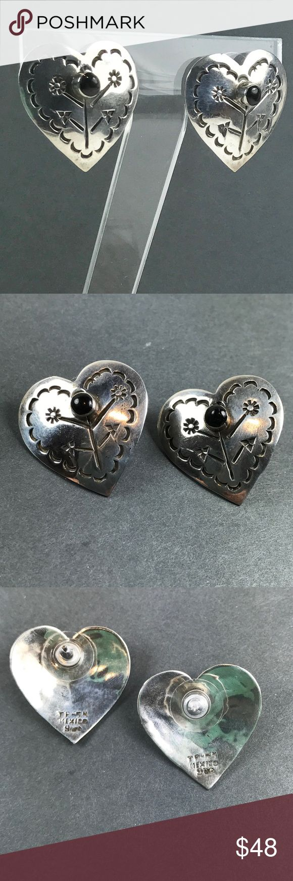 Vtg Sterling Silver Onyx Southwest Heart Earrings Gorgeous vintage Sterling Silver heart earrings Has Onyx stone and decorative marks on front  Marked on back Mexico 925 Measures approximately 1 inch wide and in length From pet and smoke free location Vintage Jewelry Earrings