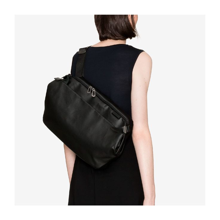 """Who said a purse should be worn on the wrist or at the elbow? The versatile Riss messenger bag, (pictured here in a black coated canvas) easily stores the necessities of daily life and a laptop of up to 13"""" in its integral padded pocket. Next time you need to take your work home with you, feel unencumbered thanks to this clever design."""