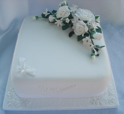Single Tier White Square Cake With Roses On Top By Helen Cakes 87 Kipling Way Stowmarket Suffolk United Kingdom Tel 01449