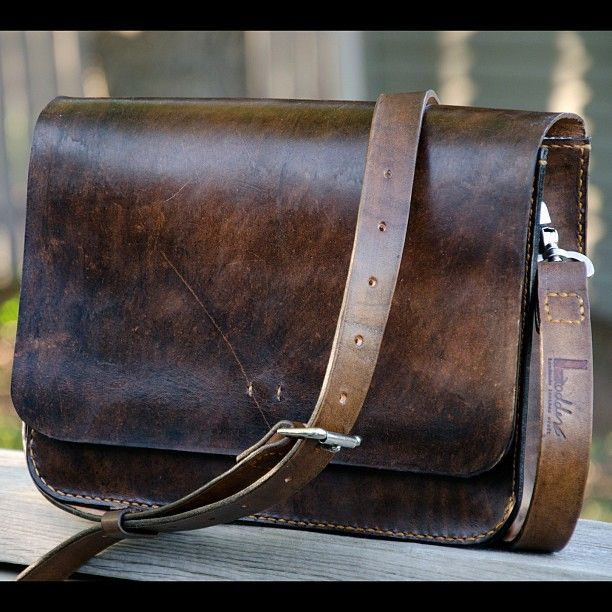 It's a satchel...not a man purse. Indiana Jones wears a sachel.