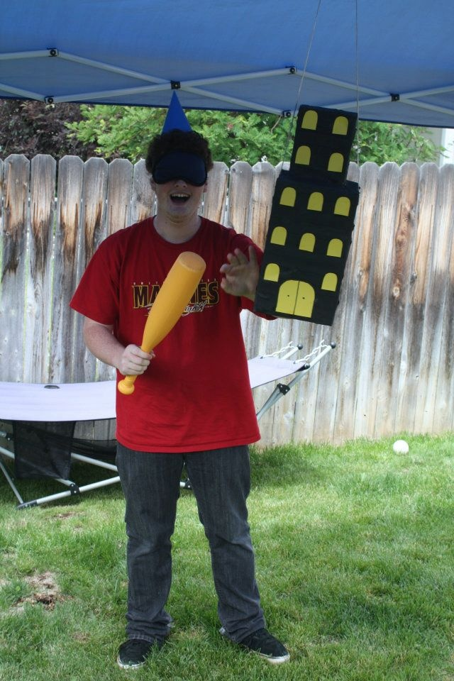 indianjones birthday party invitations%0A My little brother volunteering to finish off the tower pinata dressed with  Godzilla hat
