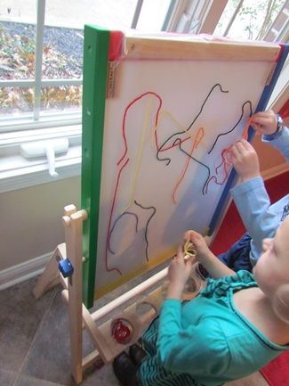 sticky board made with contact paper. Use string or construction paper pieces. a great idea would be to apply another sheet of contact paper to the sheet and hang it for art, especially if you used shapes or pieces of paper the kids colored themselves.