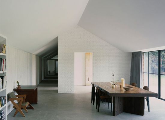 David Kohn Architects had a vision to revive the ruins of a 19th century stable in the English countryside of Norfolk. The ghost of the original structure was restored with a new take on the typical English farmhouse style. A fresh neutral palette plays host to design icons like the Jielde Signal Floor Lamp, Vitra Standard Chair, and the E15 Backenzahn Stool.