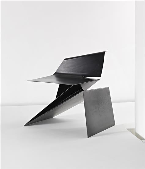 PHILIP MICHAEL WOLFSON Prototype 'Origami' chair, designed 1991, executed 2007  Folded and welded sheet steel. 70 cm. (27 1/2 in.) high Produced by Patrick Brillet/The Apartment Design & Art Gallery, Ltd., UK. From the 'left' edition of eight. Underside inscribed with signature 'p m wol
