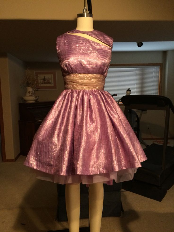 Prom or event wear cut out dress constructed with satin, organza, and tulle