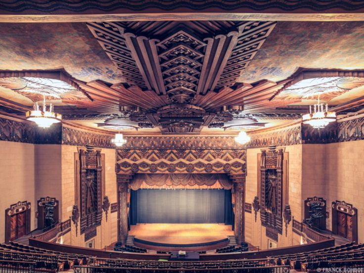 This Theater Screams Art Deco With Its Sleek Ceiling Molding And Geometric Chandeliers