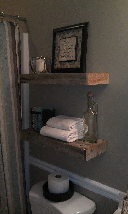 Bathroom Over Toilet Rack : Pallet wood floating shelves one behind the toilet in