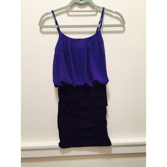 Nighttime, going out dress Black and royal blue going out dress. Body con at the bottom and flowy at the top. Charlotte Russe Dresses Mini