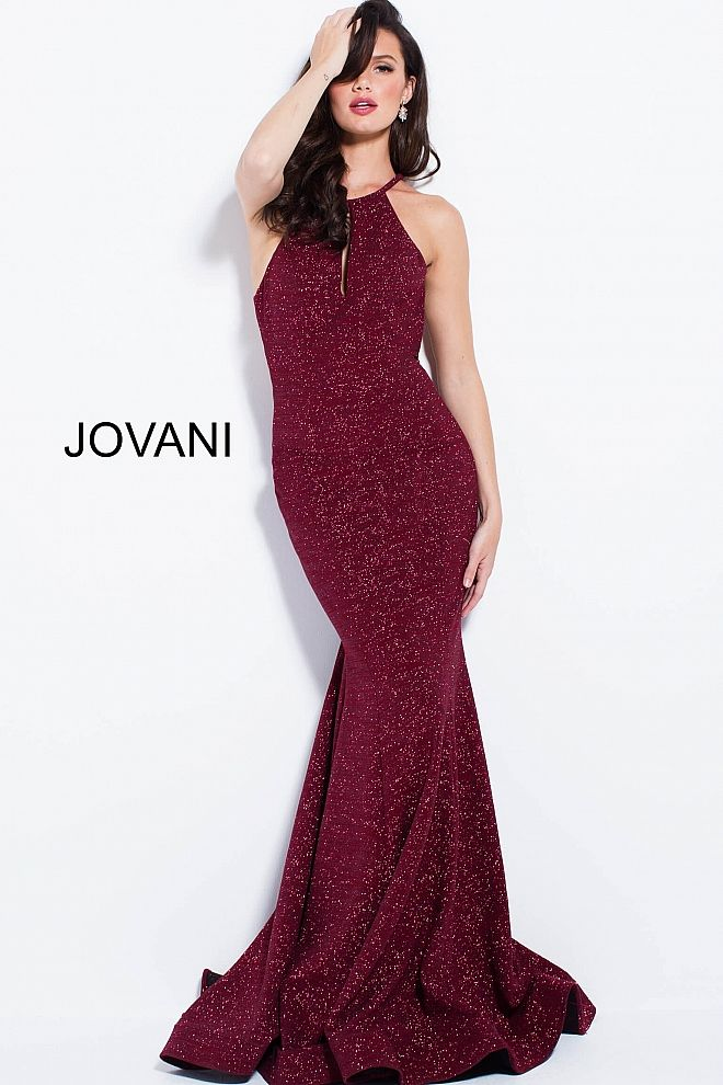 3d71ea5b1f Floor length form fitting burgundy glitter jersey prom dress features  sleeveless bodice with high key hole neckline and racer back.