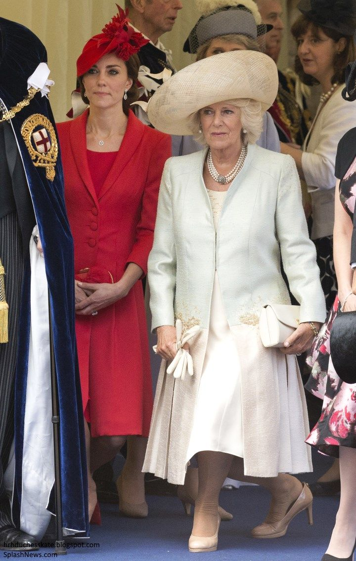 Camilla Duchess of Cornwall and Catherine Duchess of Cambridge curtsy to the Queen during the Order of The Garter Service at Windsor  Royal