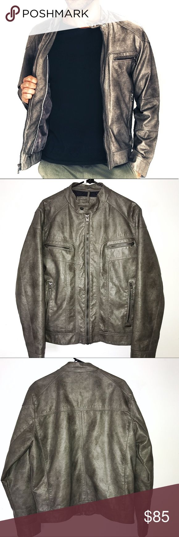 Men's Calvin Klein Moto Jacket Size medium. Brown & golden beige mixed color pallet. Moto style. Full zip front. Snap neck strap closure. (4) zipper pockets on the front. Quilted inner lining. Materials; face- 100% polyurethane. Backing- 100% viscose. Knit- polyester / cotton. Lining- 100% polyester. Filler- 100% polyester. Classic jacket for your wardrobe. Excellent condition, no outer flaws. Calvin Klein Jackets & Coats Bomber & Varsity