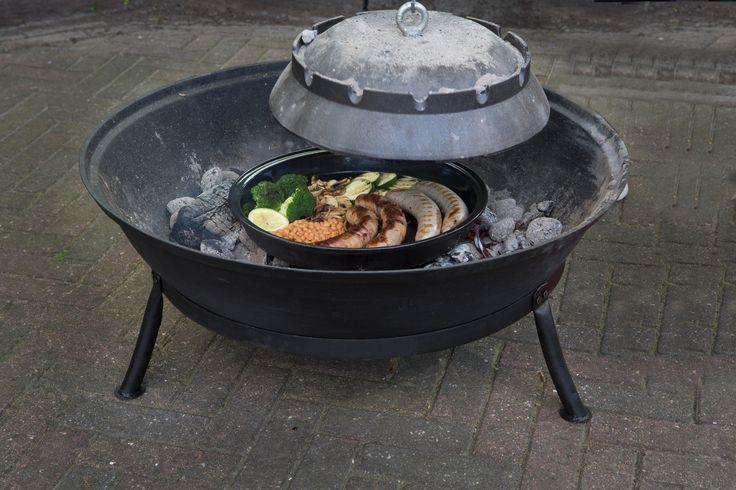 Bakken en braden op een ambachtelijk wijze buiten met een echte Dutchstove.