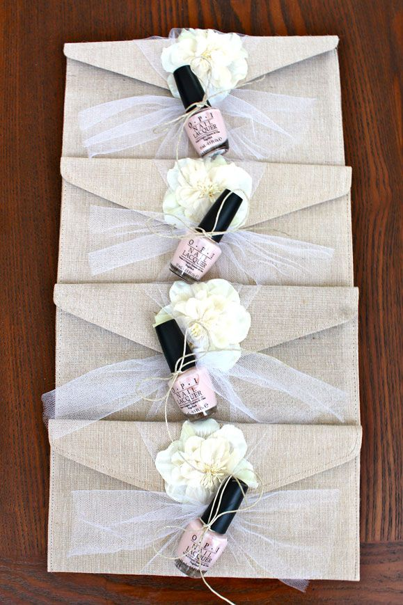 "Bridesmaids' gifts: burlap clutches - ""beachy pearl white flower"" from The Sweetest Memory on Etsy. I tied OPI ""Mimosas for the Mr. & Mrs."" nail polishes onto them"