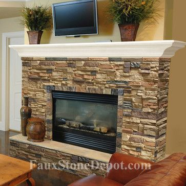 I am thinkng about something like this for our ugly fireplace in the living room... cover with faux stone....