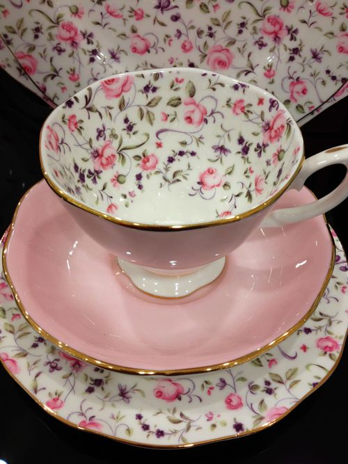 Lovely pink rosebud with lavender accents Tea cup with contrasting pink saucer.   Time for tea :)