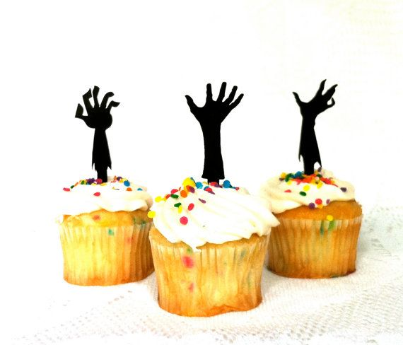 ★★ MADE IN THE USA - RIGHT HERE IN AMERICA ★★  A Set of 3 black Silhouette ZOMBIE hands.  Having a Zombie themed party? Then you need this classic set of undead Zombie Apocalypse cupcake toppers for your awesome horror themed party.  Great for Halloween, Zombie fans, Zombie themed weddings etc.  Makes a great gift for any Zombie fan, or for someone who likes to bake.  Cake topper is made with black Acrylic.  Handmade in the USA by CreativeButterflyXOX  This listing comes in a SET OF 3 cake…