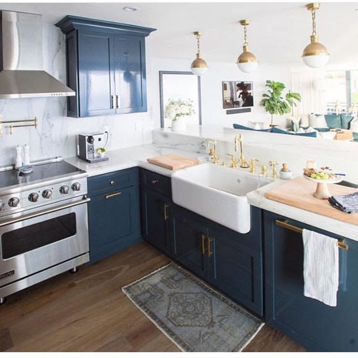 Navy blue cabinets with gold accents  Kitchens in 2019