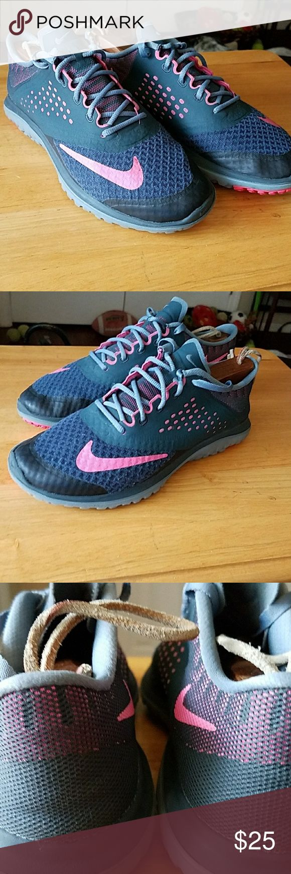 Nike FS lite run ladies trainers size 7.5 Ladies Nike Trainers in size 7.5. These were my daughter's trainers and ha e been worn a handful of times. Still have plenty of life left. Please see the pics. Colors are dark grey and pink. Nike Shoes Athletic Shoes