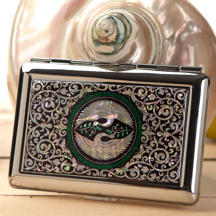 http://www.antiquealive.com/store/detail.asp?idx=4133 Mother of Pearl Cigarette Case with Double Crane Design
