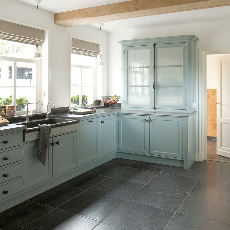 Tasty Turquoise Kitchens. Love the large grey slate tiles on the floor.