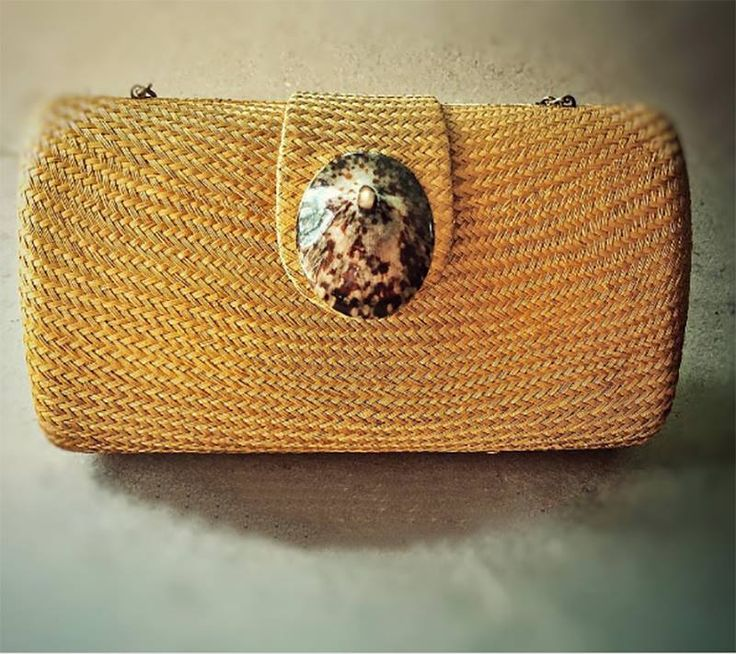 Pita in mustard yellow with shell detail. Rustic but elegant. Hard clutch glamor with nature. http://our7107islands.com/  #livefair #lifthumanity #philippineartisans #our7107islands #wearFilipino #beach #summer #essentials #lovewithacause #nature #natural #organic #handmade #handmadewithlove #bags #handbags #handbagsmanila #shopping #essential #chic #elegance #accessories #clutch #glamourwithnature