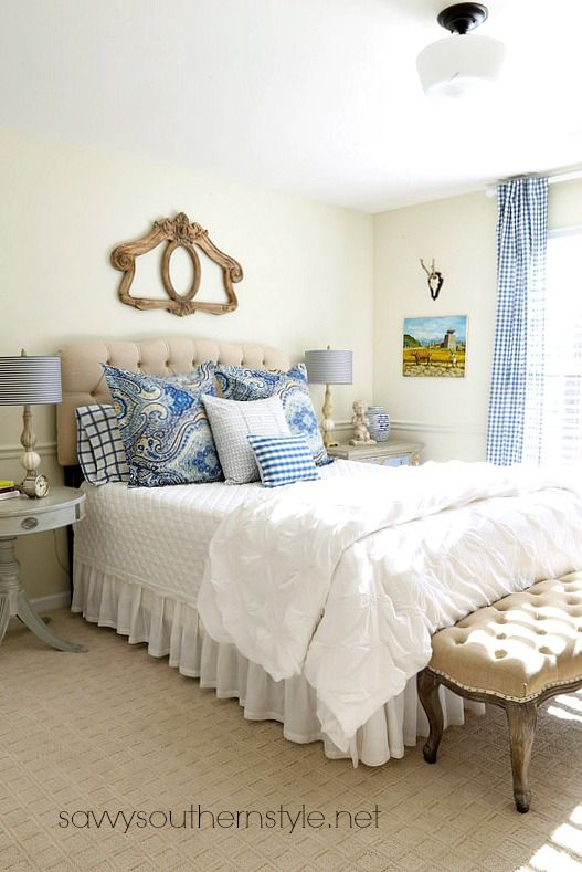 Blue and white bedroom with soft layers of bedding and a mix of patterns. French country, traditional, checks, tufted headboard, tufted bench, white, color, vintage, new.