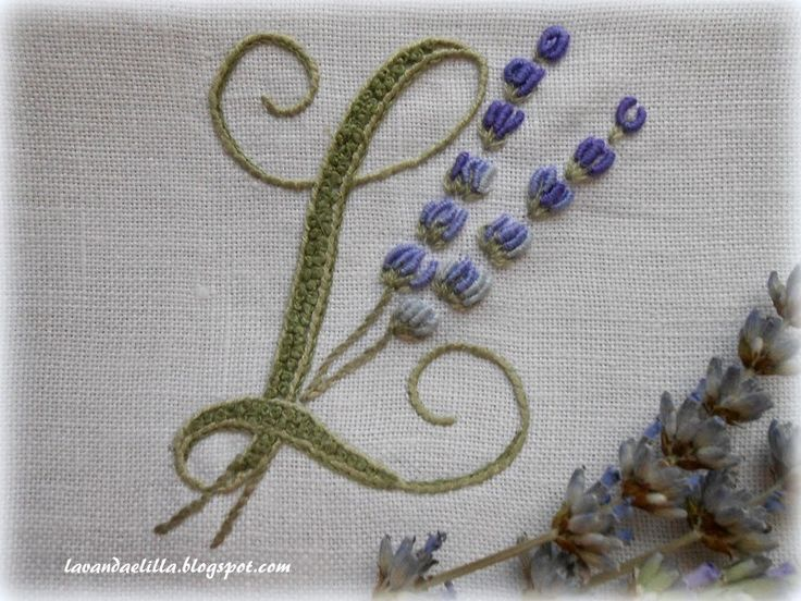 Lavender and lilac French knots in the letter.