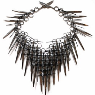 Carrie May Rose. Neckpiece with scissors and black cable ties.