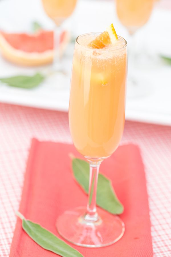 Grapefruit Mimosas Fill the glass half way with Fresh Grapefruit Juice Squeeze the juice of one orange wedge into the glass Top off with cold Champagne