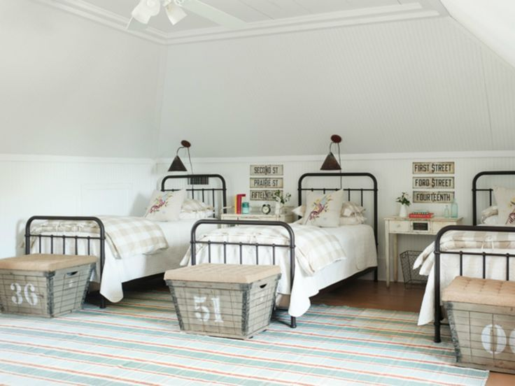 Iron beds in a grown-up bunk room